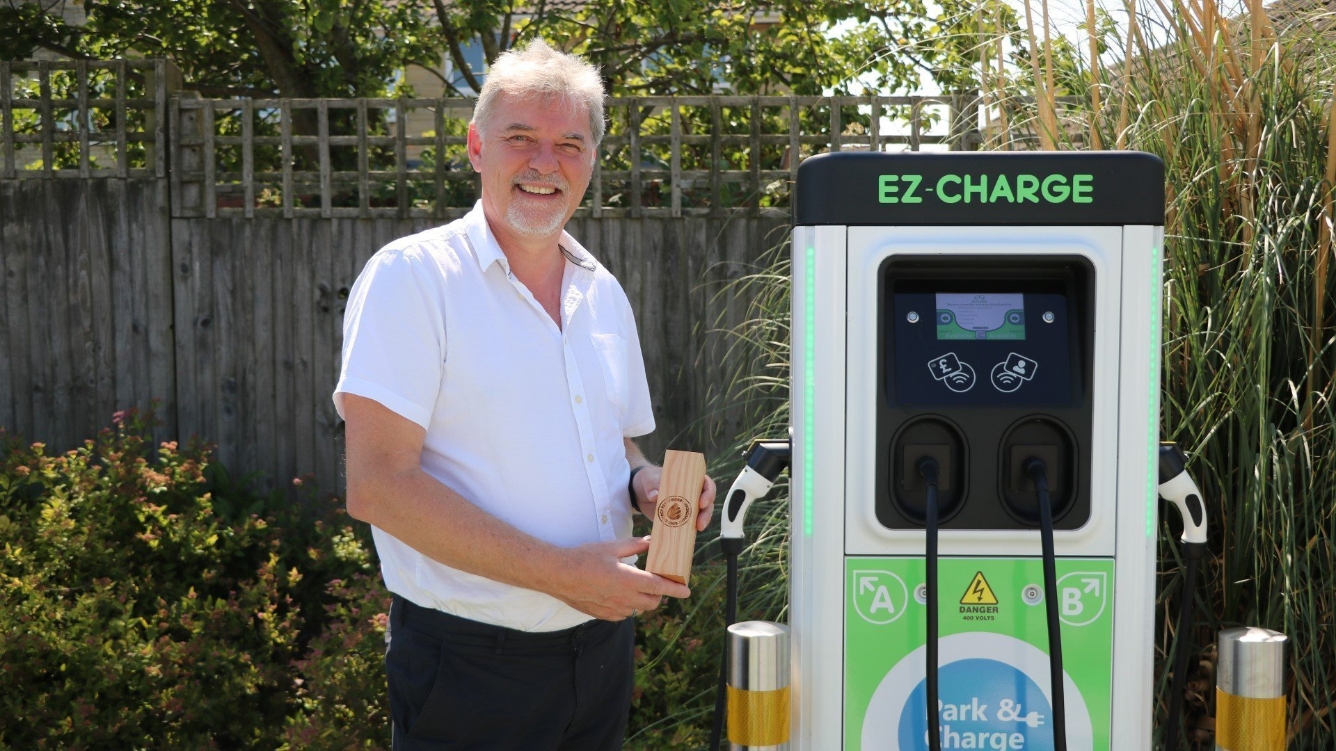 Bicester company wins search for leading green transport and infrastructure innovators. Image: Phil Shadbolt, Chairman at EZ-Charge, with one of six EZ-Charge units located at Bicester Cattle Market