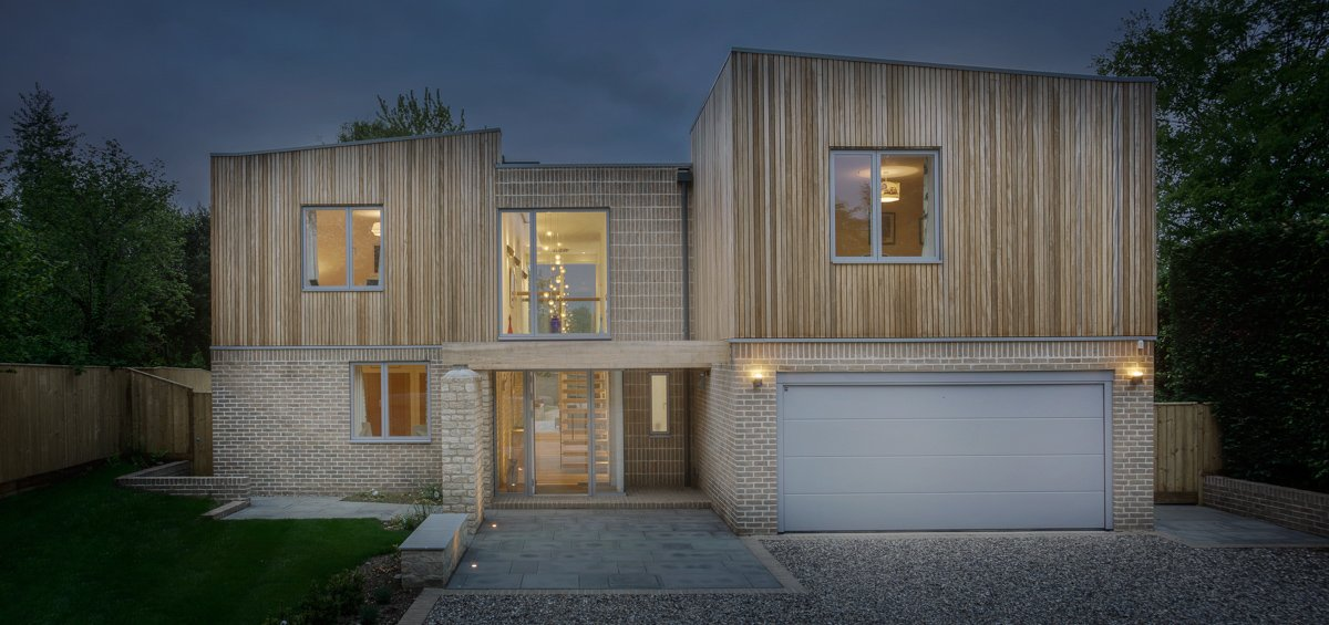 Sustainable Dwelling by Allister Godfrey Architects - Front Exterior View at Night