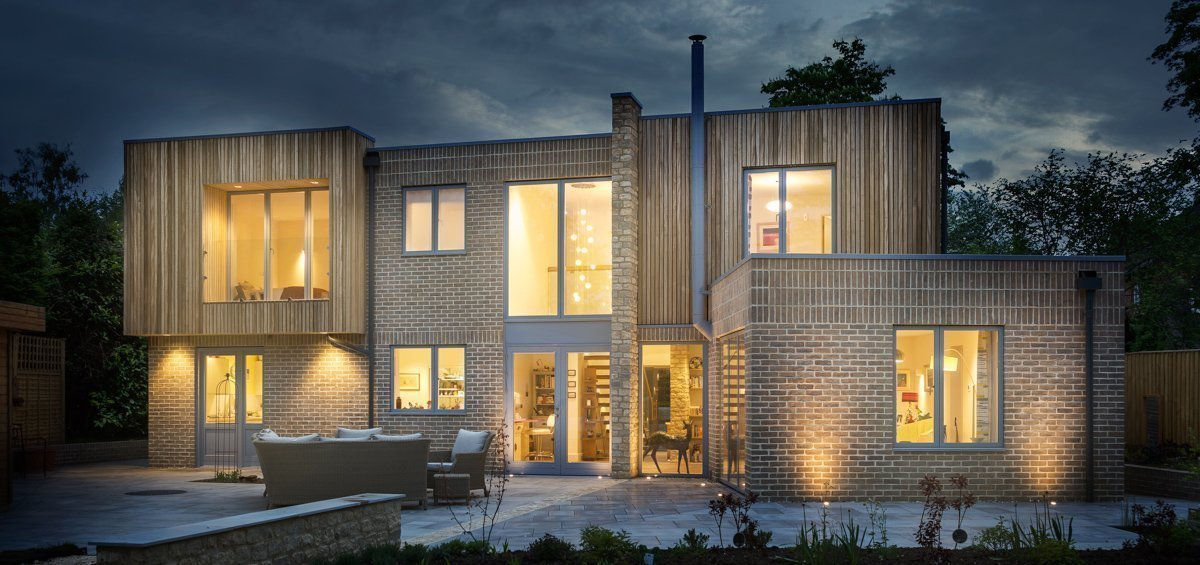 Sustainable Dwelling by Allister Godfrey Architects - Rear Exterior View at Dusk